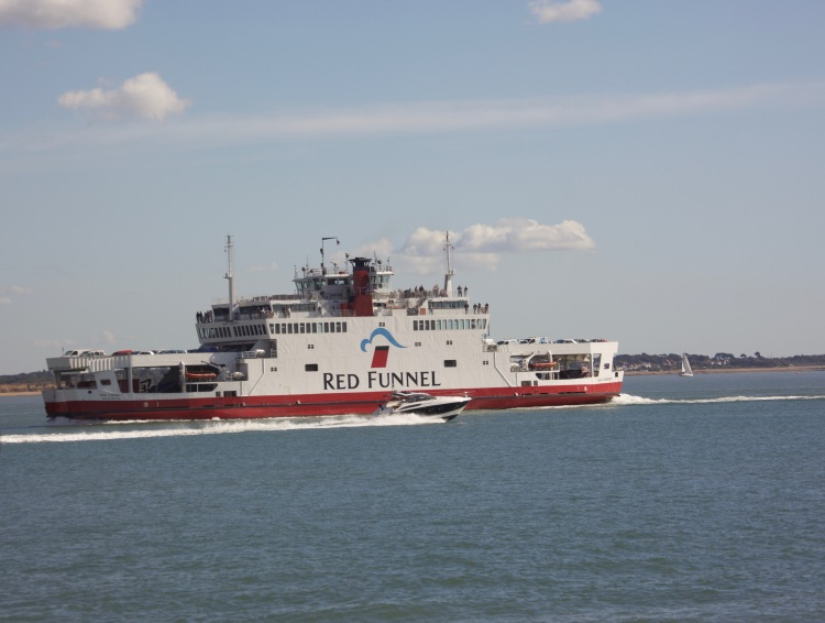 Speedboat passing Red Funnel ferryboat