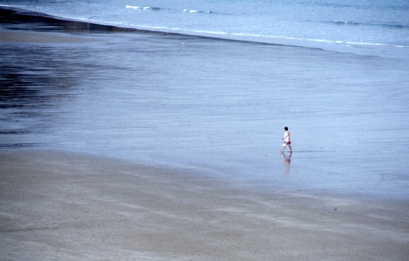 Woman crossing beach 9.82