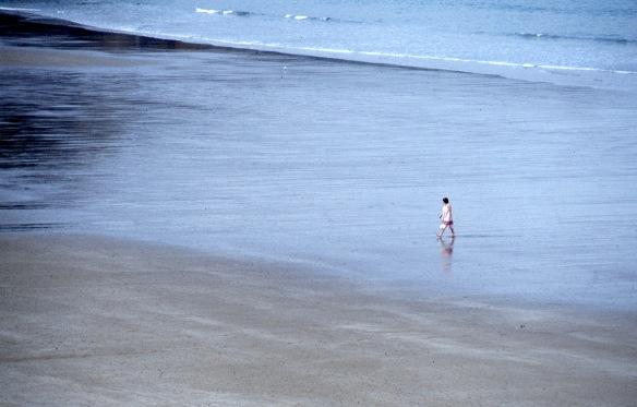 Woman crossing beach 9.82