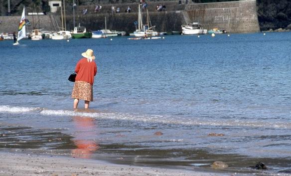 Woman with handbag wading 9.82 2
