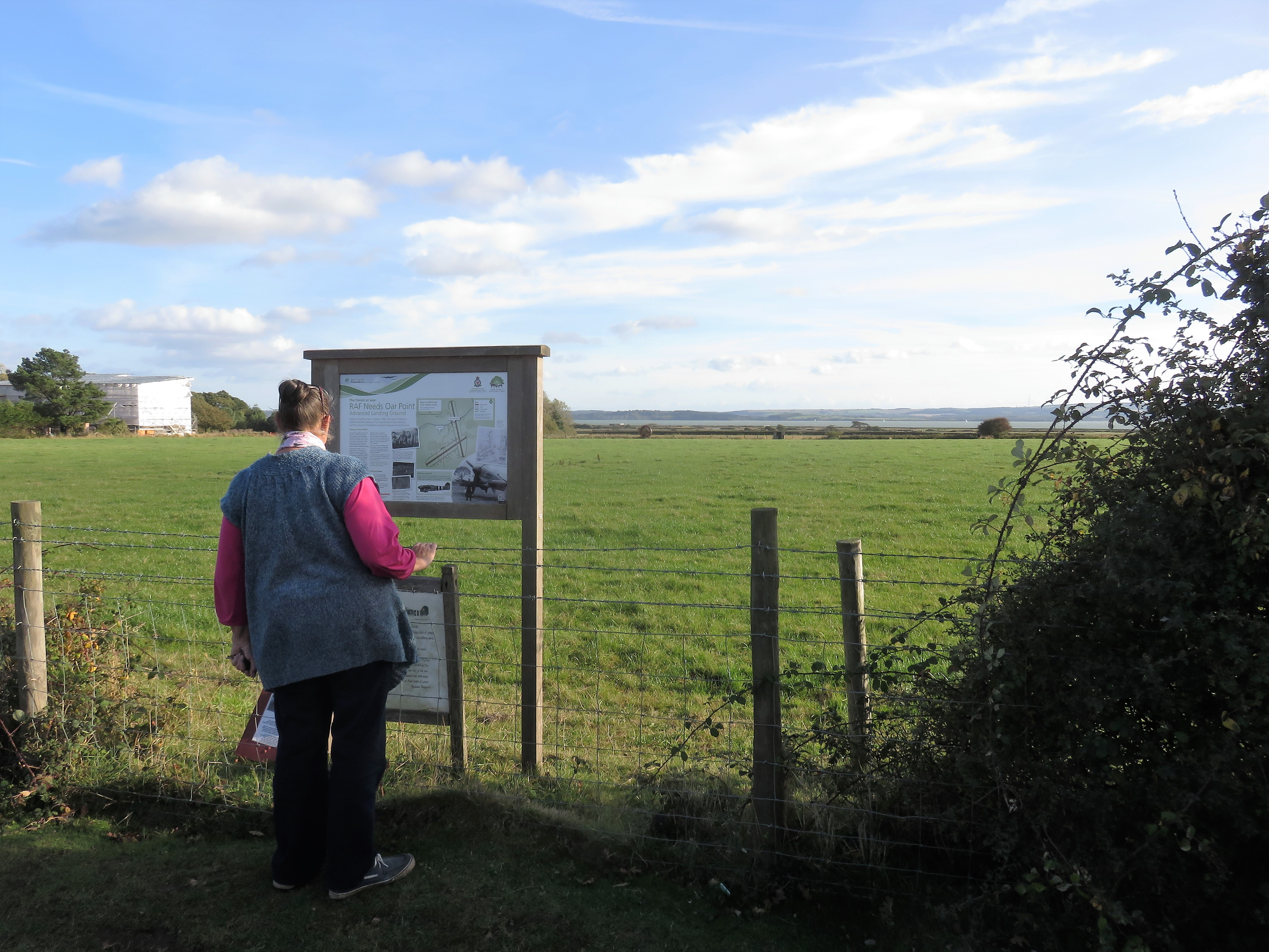 Jackie reading RAF Needs Oar Point sign
