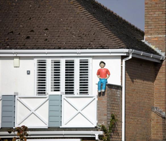 Boy sculpture on wall