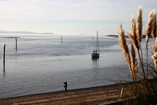 Moored yacht and woman observer