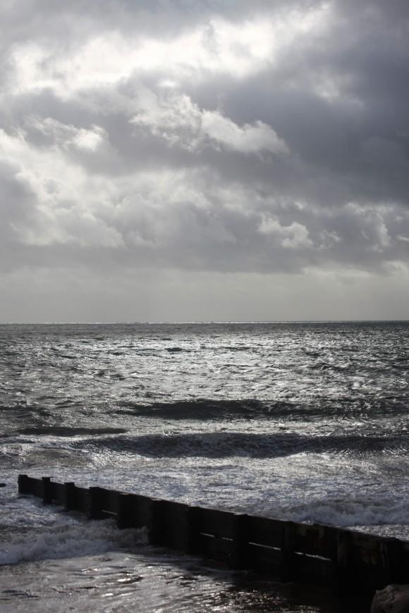 Clouds, sea, breakwater