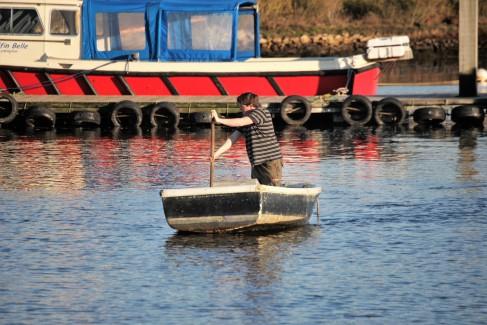 Fisherman in rowing boat
