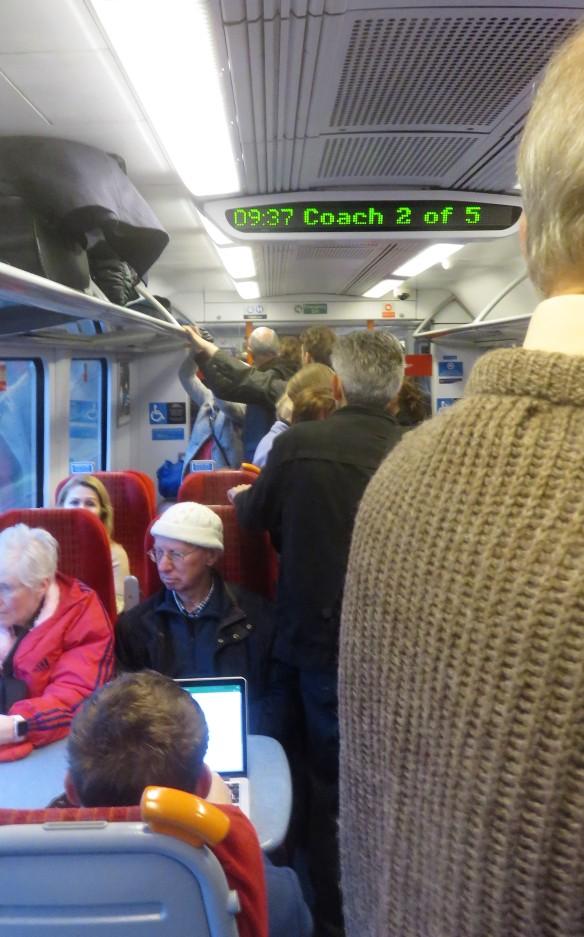 Standing train passengers