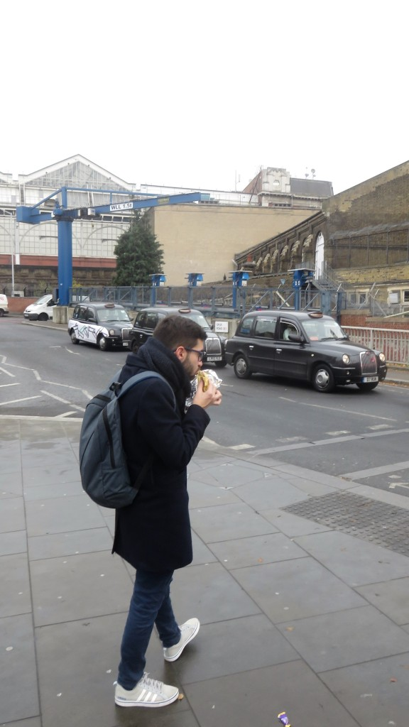 Man eating in street