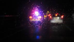Car lights through wet windscreen