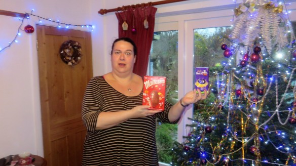 Becky at Christmas tree with Easter eggs
