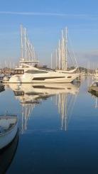 Boat reflections full length