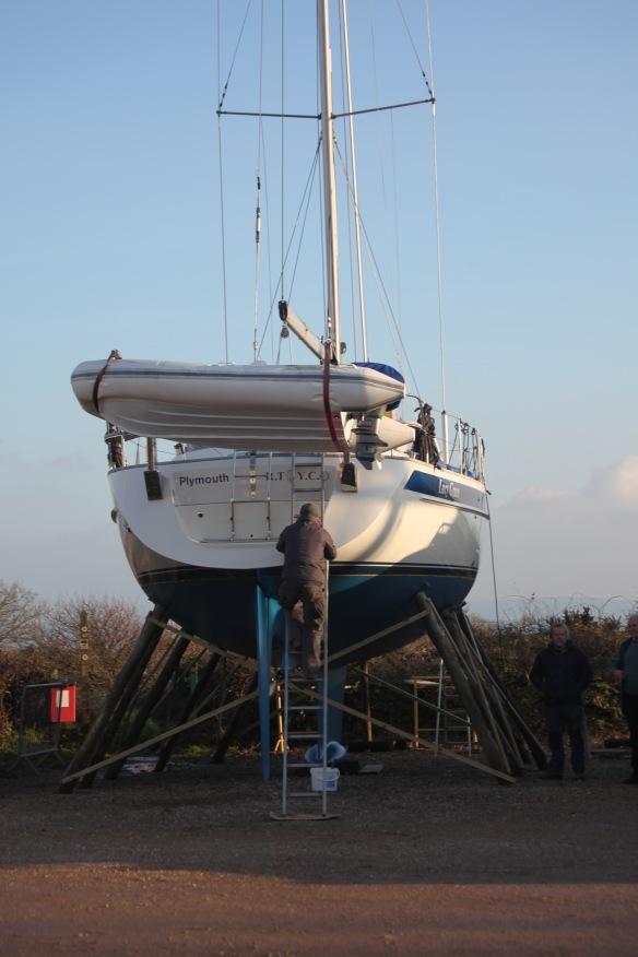 Man climbing from hull