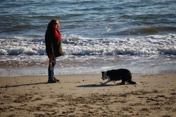 Woman and dog on beach