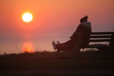 Sunset with woman on bench