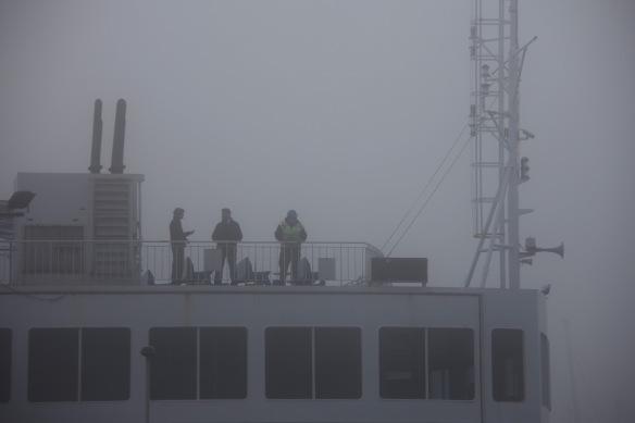 Ferry crew in fog