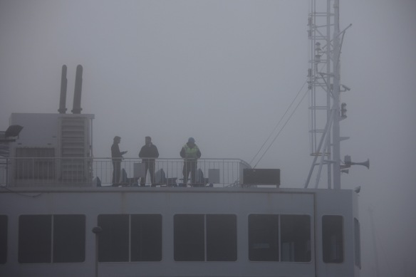 Ferry crew in fog