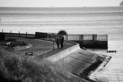 Walkers on sea wall 1