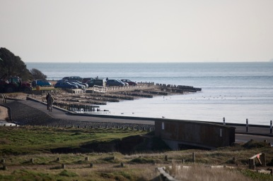 Walkers on sea wall 2