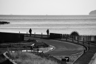 Walkers on sea wall 3