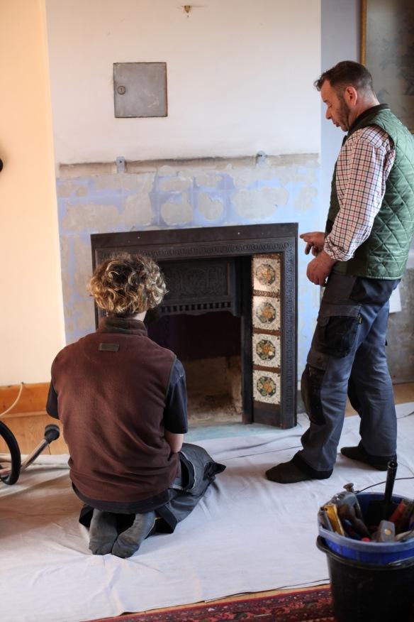 Baz and Owen contemplating fireplace 1