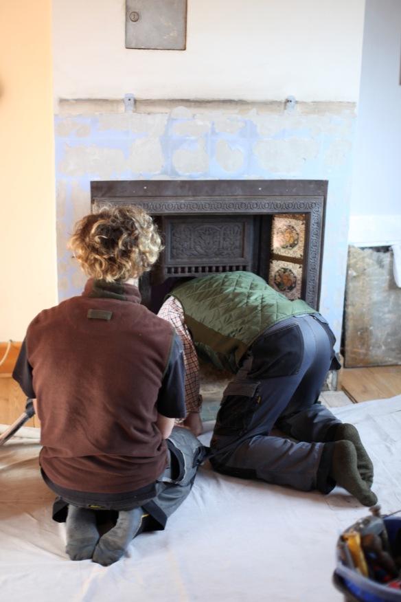 Baz and Owen contemplating fireplace 2