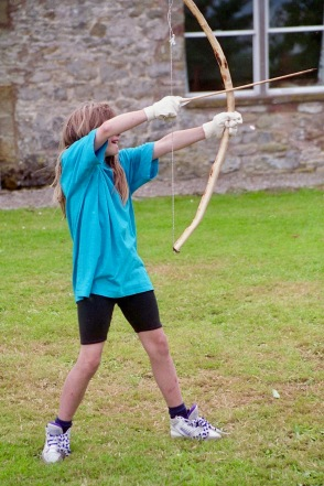 Louisa firing bow and arrow 21.8.92 1