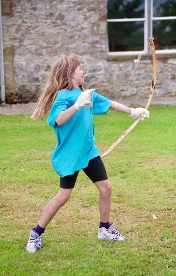 Louisa firing bow and arrow 21.8.92 2