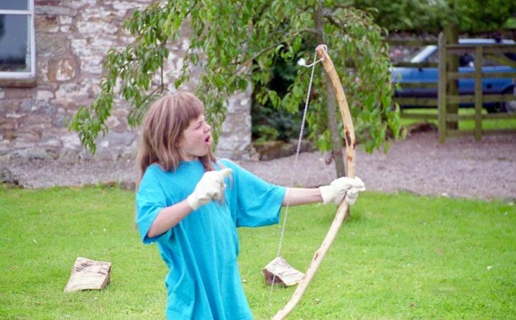 Louisa firing bow and arrow 21.8.92 3