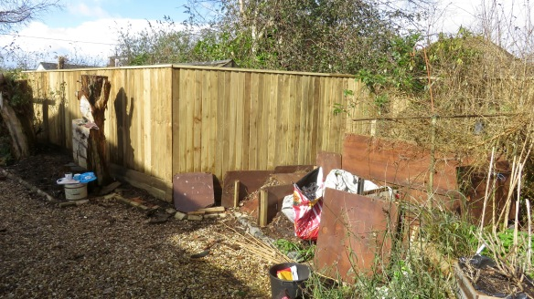 Fence and compost bins