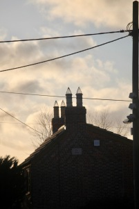 Rooftop, chimney caps, telephone wires