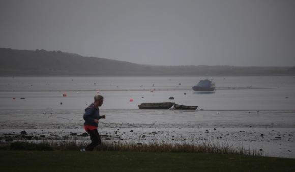 Jogger and boats