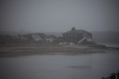 Beach huts in mist 2