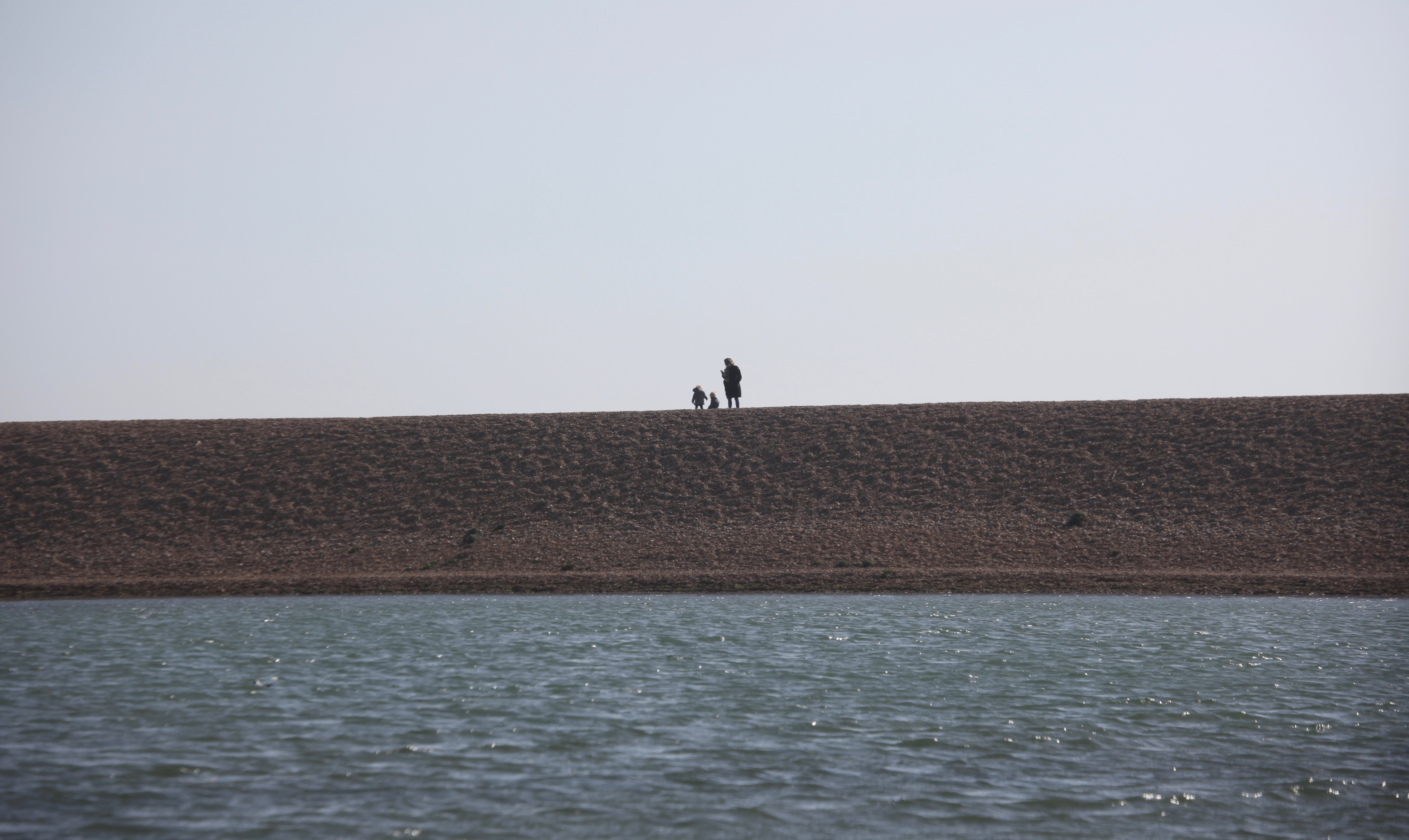 Woman and children on Hurst spit