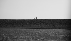 Woman and children in silhouette on Hurst spit