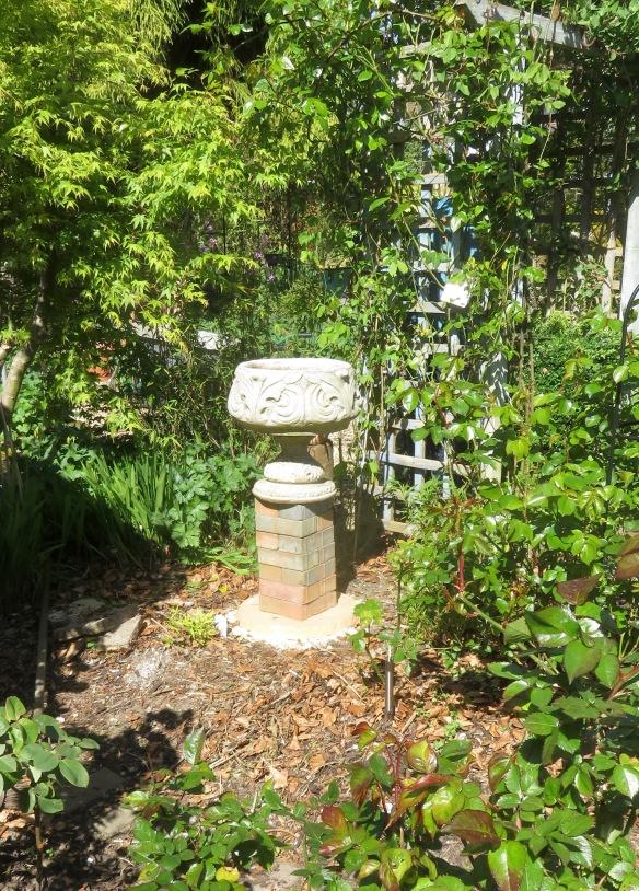 Urn on brick pillar