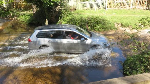 Car driven through ford