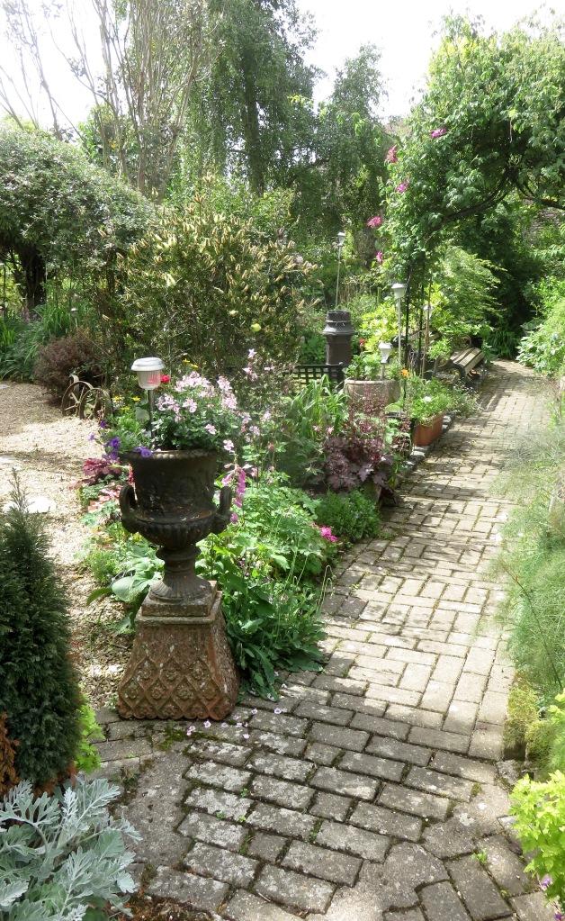 Garden view from iron urn