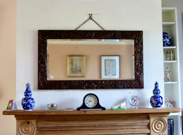 Mirror and mantelpiece