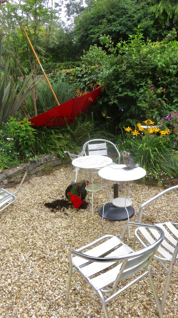 Upturned pot and parasol