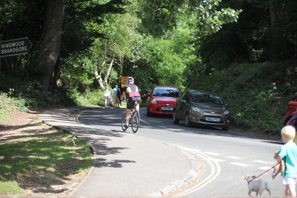 Cyclist, walkers, and cars