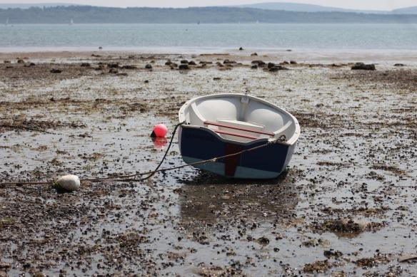 Boat on low tide beach