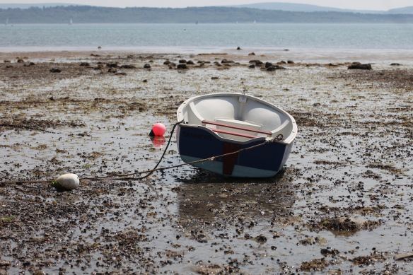 Boat on low tide beach