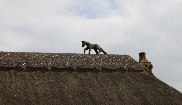 Straw horse on rooftop