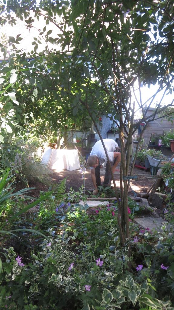 Aaron laying greenhouse base 9