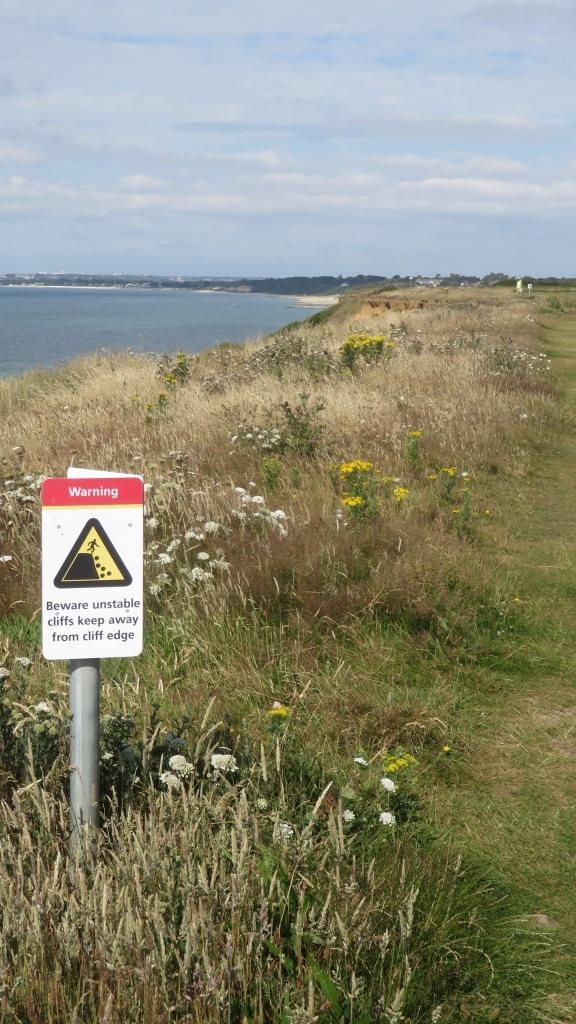 Beware unstable cliffs sign