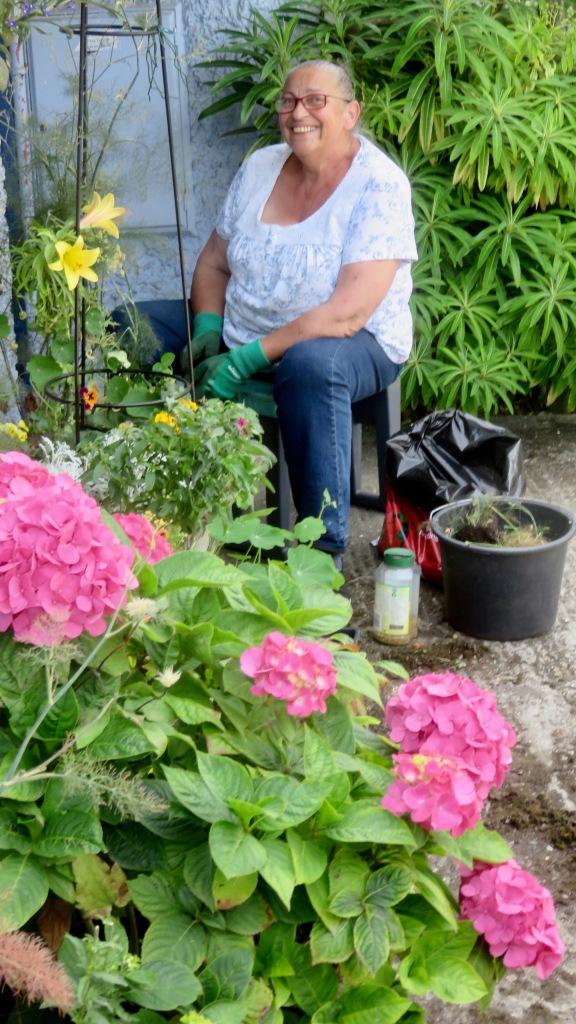 Jackie tending front pots 2