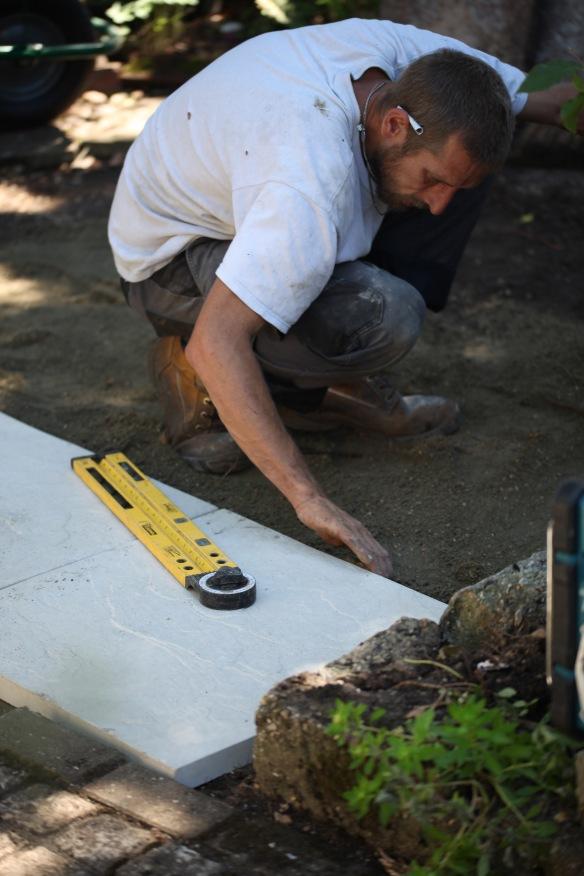 Aaron laying greenhouse base 6