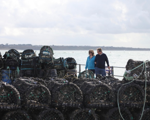 Couple looking at crab pots
