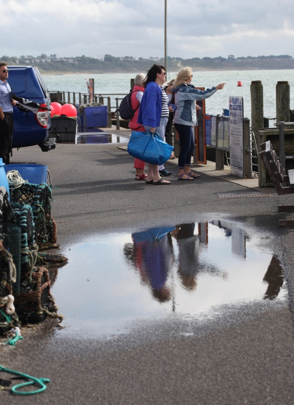 Queuing for ferry with reflection
