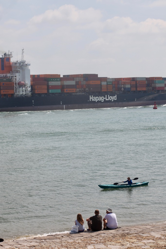 Watching container vessel and kayaker