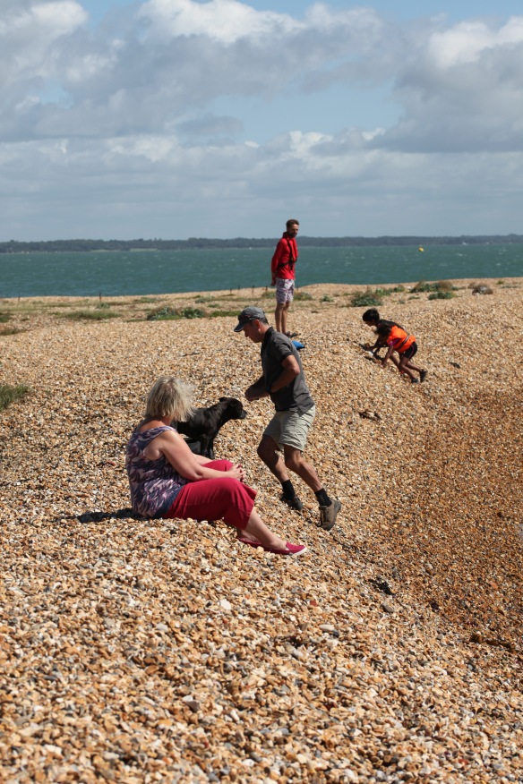People on shingle bank